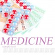 Prescription drugs on money background, representing rising health care costs, isolated on white — Stock Photo #51433133