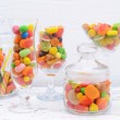 Different colorful fruit candy in glasses on table on light background — Stock Photo #51433481