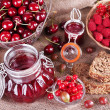 Berries jam in glass jar on table, close-up — Stock Photo #51433931