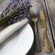 Dining table setting with lavender flowers on wooden table background — Stock Photo #51434217