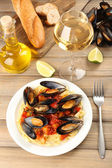 Tasty noodles with mussels on table, close up — Stock Photo