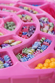 Multicoloured beading kit for children in a pink box  — Stock Photo