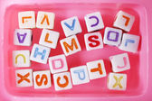 Multicoloured beads for children in a pink box — Foto Stock