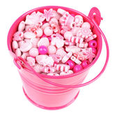Beads for children in coloured metal bucket isolated on white — Stock Photo