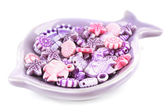 Beads for children in ceramic dish isolated on white — Stock Photo