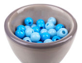 Beads in ceramic stand isolated on white — Stock Photo