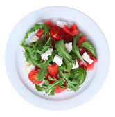 Salad with watermelon, feta, arugula and basil leaves on plate, isolated on white — Stock Photo