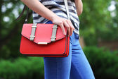 Girl with bag over his shoulder outdoors — Stock Photo