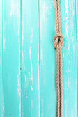 Marine knot on wooden background — Stock Photo