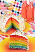 Delicious rainbow cake on plate on table on bright background — Stock Photo