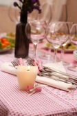 Buffet table with dishware and candle waiting for guests — Foto Stock
