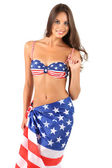 Woman in swimsuit with American flag — Stock Photo