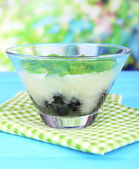 Melon smoothie in glass bowl on table on bright background — Stock Photo