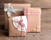 Cute gift boxes on wooden background — Stock Photo