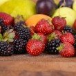 Ripe fruits and berries on wooden background — Stock Photo #51445027
