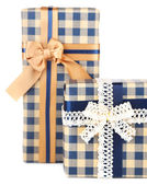 Gift boxes with colorful ribbon isolated on white — Stock Photo