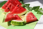Fresh slices of watermelon on table, outdoors — Stockfoto