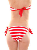 Young woman with slim body in swimsuit isolated on white — Stock Photo
