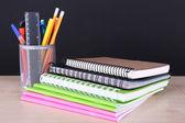 School supplies on table on dark background — Stock Photo