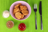 Chicken nuggets with sauces on table close-up — Stock Photo