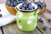 Fresh blueberries on wooden table — Stock Photo