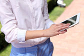 Woman with tablet on city street — Stock Photo