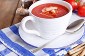 Tasty tomato soup with croutons on wooden table — Stock Photo
