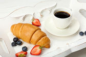 Delicious breakfast with coffee, fresh croissant and berries — Stock Photo