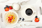 Delicious breakfast with coffee, egg and oatmeal — Stock Photo