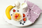 Delicious breakfast with oatmeal and milk — Stock Photo