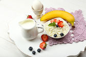 Delicious breakfast with cottage cheese, milk and fruits — Stock Photo