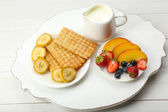 Delicious breakfast with milk, cookies and fruits — Stock Photo
