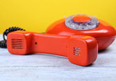 Retro red telephone on color background, close up — Stock Photo