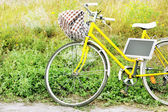 Bicycle with chalkboard in meadow during sunset  — Foto Stock