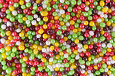 Colorful sugar sprinkles background — Foto Stock
