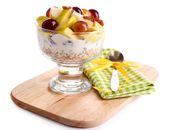Healthy breakfast - yogurt with  fresh grape and apple slices and muesli served in glass bowl on wooden tray, isolated on white — Stock Photo