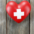 Red heart with cross sign on wooden background — Stock Photo #51455349