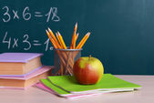 School supplies on table on board background — Стоковое фото