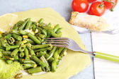 Salad with green beans and corn,  on plate, on color wooden background — Stock Photo
