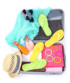 Suitcase with things for travelling — Stock Photo
