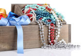 Grey drawer full of multicoloured ribbons and beads on white background isolated — Stock Photo