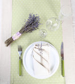 Dining table setting with lavender flowers on table background — Stockfoto