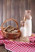 Tasty snack in basket on wooden background indoor — Stock Photo
