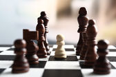 Chess board with chess pieces on light background — Foto de Stock
