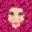 Woman beauty face with beautiful flowers frame, close-up — Stock Photo #51651051