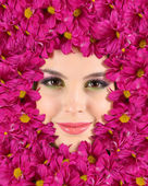 Woman beauty face with beautiful flowers frame, close-up — Стоковое фото
