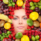 Woman beauty face with fruits frame, close-up — Stock Photo