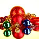 Many christmas toys on yellow background — Stock Photo #6660658