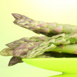 Delicious asparagus on plate on green background — Stock Photo #8687010
