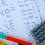 Math on copybook page closeup — Stock Photo #8699087